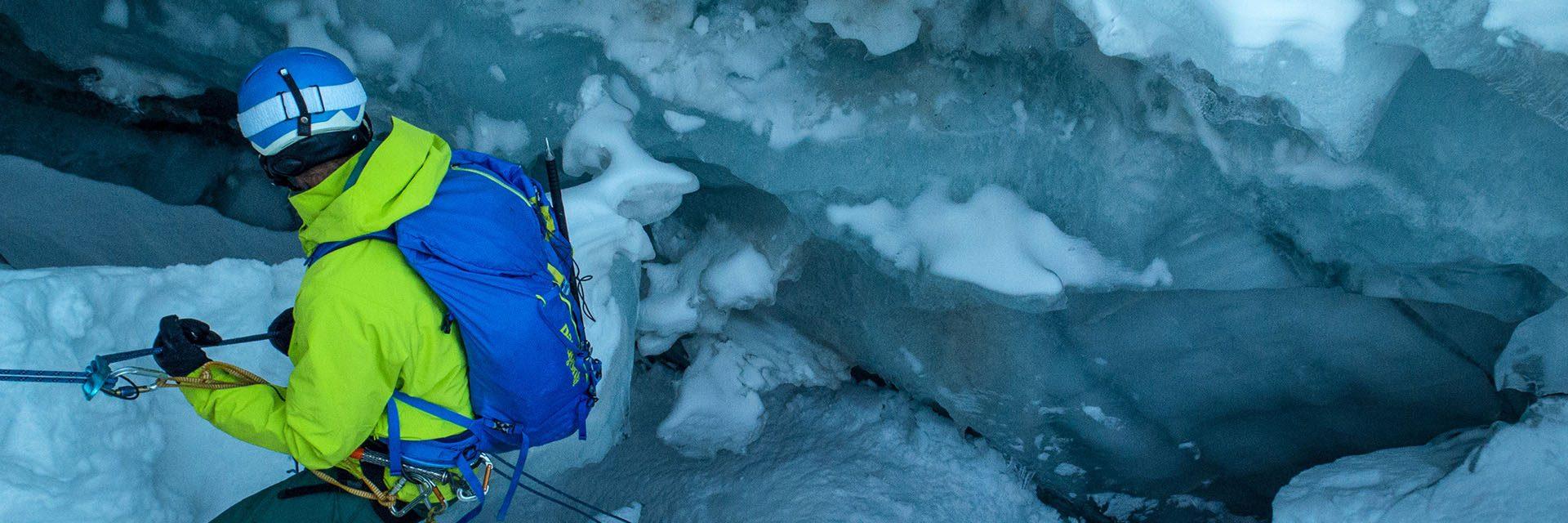 Stephan Verheij rappelling into a crevasse
